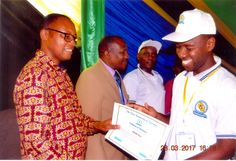 Mr. Moyo receives a certificate after completed the training on effective communication, leadership, drug abuse and HIV/AIDS offered by The Open University of Tanzania on 28th March, 2017.