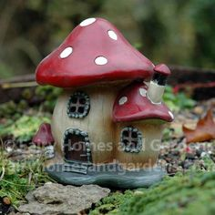 "At just 7"" high x 4"" wide, this whimsical little fairy cottage is small enough for a container garden. The mushroom cottage will light up with the help of 2-AA batteries (not included)."