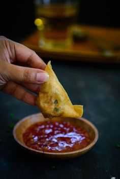 Crab rangoon is a very famous Chinese snack made with a cream cheese and crab meat filling filled inside wonton wrappers and then deep fried. #Snacks #Appetiser #Recipe #Food #Photography