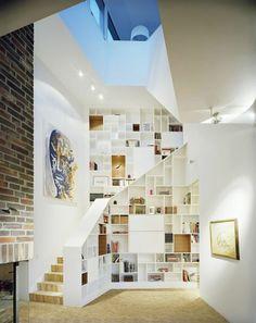 Shelves on outside of stair railings.  Nice.