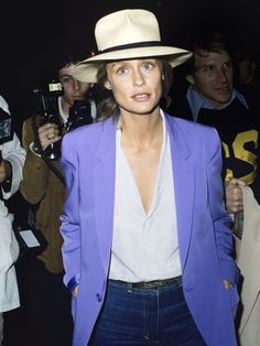 Lauren Hutton, hat, purple blazer, jeans, light blue shirt
