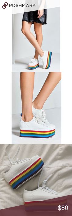 Rainbow Platform Sneakers Perfectly in tune with this season's '90s attitude, Jeffrey Campbell's sneakers (similar to the most Instragrammed piece from Gucci's Resort '17 runway that's cost $1k). Crafted from leather, set on a towering yet lightweight rainbow-striped platform. Showcase yours with cropped denim. NEVER WORN OUTSIDE. Comes with original box. I LOVE these but the 7.5 fits like an 8!! Jeffrey Campbell Shoes Platforms