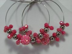 """Basketball wives inspired hoop earrings in pink and silver beads. Large hoops measure 2-1/2"""".  $2.00  Available at www.blingychics.com"""
