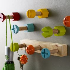"""Hardware Hook 3-Peg Wall Hook ~ """"Our 3-peg Hardware Wall Hook is made of oversized replicas of iconic hardware affix to your wall. Brightly colored wooden nails, screws and bolts will hold your coats, sweaters or hats. Use multiple hooks in the mudroom or to brighten any kids room."""""""