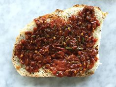 Is it a fruit or is it a vegetable? All we know is that we want to slatherthis savory tomato jam on everything. Packed with flavor thanks to fresh rosemary and tangy balsamic, with a thick texture due to the nature of Roma tomatoes, it's the perfect condiment for amping up a grilled cheese or burger. It also makes a great addition to pasta, with a few spoonfuls adding a little homemade flavor to store-bought sauce.