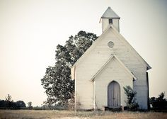 aAbandoned  -  not too far from the city, but yet far away enough to go unnoticed. that's where this old church is sitting. small and probably remembers a lot. today it's abandoned, windows are covered with wood panels and it doesn't look like anyone cares about cutting the grass around it.