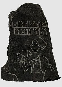 """An early runestone: the Möjbro Runestone from Hagby (first placed near Möjebro), Uppland, Sweden. As with other early runic inscriptions, (e.g. Kylver Stone from about 300 - 400 CE) this is written from right to left, while later Runestones were written from left to right.[citation needed] The text is """"Frawaradar anahaha is laginar"""""""