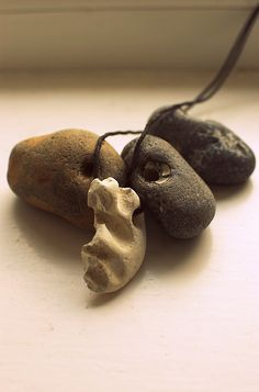 Hag stones. Traditional amulets. Stones with natural holes right through them are magical, they make it possible for people to see the spirits in the world, and they give the owner good luck and protection.
