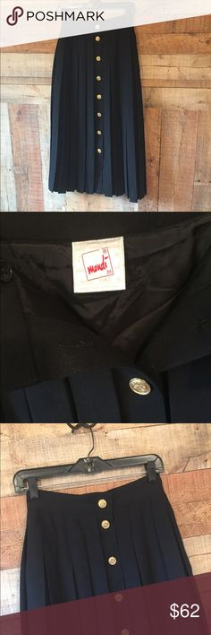 "VTG Mondi Pleated Skirt EUC Full button up front black wool blend skirt.  Pleated all the way around.  German size 36 which equals a 4-6 US.  Waist measures 13"" across and almost a full 33.5"" long with 8 gold-tone buttons.  45% new wool, 55% poly.  Fully lined.  This is a beautiful vintage skirt! Mondi Skirts"