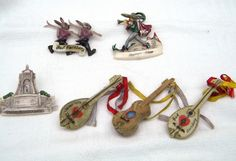 VINTAGE CELLULOID SOUVENIR BROOCH / PIN  X 6 SKIING  GUITAR PIED PIPER   ETC
