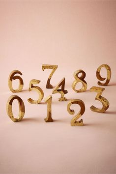 Gold Teak Wood Numbers. I'd use it forming the New Year out and place it on the bar or dessert table as decor.