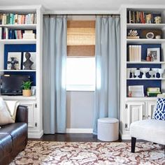 See how this blank wall was transformed with secondhand bookshelves, trimmed out and backed in nautical blue paint. | thisoldhouse.com