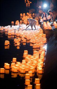 Obon Festival: Japanese Buddhist worshippers place one thousand floating paper lanterns in a river in Ichinomiya city. Credit: © EVERETT KENNEDY BROWN/epa/Corbis   www.eklectica.in #eklectica
