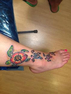 I LOVE the sea turtle tattoo on my foot! Inked by Scott Martin in Oahu. It's based on art by brilliant watercolor artist, Christie Marie. The Hawaiian Honu (sea turtle) represents longevity, safety and Mana (spiritual energy). Native Hawaiians consider her the bearer of good luck and peace. Many Hawaiians worship the Honu as their 'aumakua' or ancestral spirit guide whose wisdom protects and leads them throughout their lives. The Honu is honored for the wisdom that comes with age.