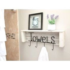 $62.99 · Rustic towel hanger on reclaimed wood has hooks and spells 'towels'.Handmade in Texas, the USA from real, reclaimed wood. The deep, eccentric texture of the weathered wood creates a genuinely rustic feel and makes this item a real eye catcher. Features Handmade in Texas, USA Hardware Finish: Black Hooks Included: Yes Number of Hooks: 4+ Mount Type: Wall Mounted Mounting Hardware Included: No Tools Needed for Installation: Drywall anchors, drill/screwdriver Product Details Ma..