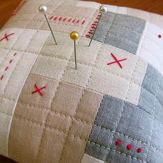 Quilted Patchwork Pincushion #1 | BooDilly via Flickr ..... made from various muslin and grey cotton - machine quilted - hand stitched