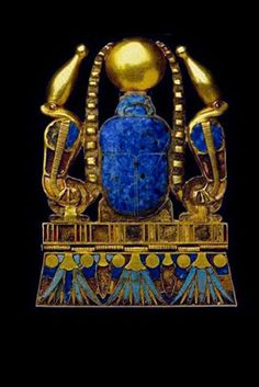 Ancient Egyptian jewel:The cobras of protection on each side wear the crown of Upper Egypt, the Lotus & Suns on the bottom edge represent immortality; Lapis Lazuli-the sky & stars;Turquoise-long life; Carnelian-protection. The Shen-immortality & protection; the Crook represents power. The Square is the Earth & the 3 bars are for the cycle of birth, death & rebirth.The scarab sits atop the mountain or afterlife.