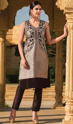 Flaunt your style dressed in this brown color embroidered silk pant style suit. You'll be able to see some intriguing patterns carried out with lace and resham work. #straightcutdress #silksuit #kotystyledress