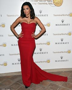 Dressed to impress: Eva turned out in a floor length red dress to collect her award...