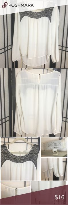 """Soulmates sheer and lace high low blouse Selling one soulmates blouse. This blouse has cinching on end of sleeve's, lace neckline, and button closure on back. Has high low bottom hem. Sleeve length: ~ 21.5"""" Chest: 40"""" Length: Front approximately 25"""". Back approximately 29"""" Color: cream/white and black Materials: 100% polyester Free from snags, or holes.  Small stain on back bottom hem shown in last photo. Soulmates Tops Blouses"""