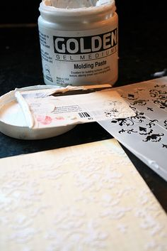 Molding Paste & Stenciling / Pate  This technique is a lot easier to achieve than one might think. You need some molding paste, an old key card (or credit, or gift card) a stencil and some paper. by art scrap & more (Alexandra S.M.)