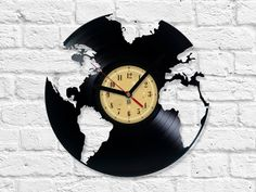 Vinyl Record Clock - World We made our clocks from old , used vinyl records. Thanks to our passion to music we give a new life for used and forgotten vinyl records, we make them functional, beautiful and great looking part of y Vinyl Record Crafts, Used Vinyl Records, Vinyl Record Clock, Vinyl Art, Record Decor, Vynil, Diy Clock, Clock Ideas, World Globes