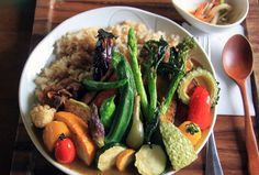 healthy curry with grilled vegetables on top
