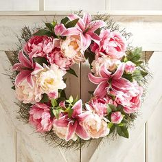 Increase your home's curb appeal instantly with our handcrafted pretty-in-pink wreath on your covered front door. Featuring two all-time favorite flowers—peonies and lilies—each strikingly realistic bloom is a beauty, generously sized and densely arranged to add extra oomph.