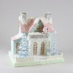 """Santa is wishing you Happy Holidays! - 10"""" H x 7.56"""" W x 10"""" L. - Pressed paper putz house with batting and mica glitter snow. - Pre-lit with LED light. - Imported."""