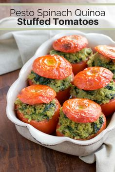 Pesto Spinach Quinoa Stuffed Tomatoes If you like stuffed peppers you'll LOVE stuffed tomatoes! Roasted stuffed tomatoes that are filled to the brim with a flavorful mixture of pesto quinoa and fresh spinach. Vegan, dairy-free, and gluten-free. Vegan Dinner Recipes, Vegan Dinners, Vegan Recipes Easy, Vegetarian Recipes, Cooking Recipes, Dairy Free Quinoa Recipes, Dairy Free Pesto, Dessert Recipes, Pesto Spinach