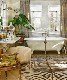 eclectic and eye-catching luxurious bathroom with bold black and white patterns, pops of green, and feminine touches - Recreate This Luxurious Bathroom: Exotic and Feminine Details from Bathroom Bliss by Rotator Rod