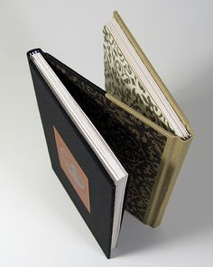 Maybe the coolest book binding ever.  Would love this binding for my grandmother's recipes, maternal on one side and paternal on the other.