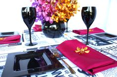 Linen, Vases and Floral Design - Decor It Events. Vogue Style Linen with Raspberry napkins in Black Gloss Fish Bowl #centerpiece #tablelinen #styling #newspaper #linen #blackandwhite #weddings #events #wedding