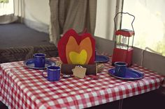 Cute idea for place setting for camping theme birthday. Even more good ideas from this party on hwtm.com.