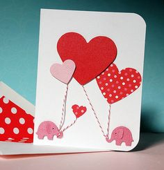 handmade Valentine card ... tiny punched elephants with huge heart balloons ... cute idea ...