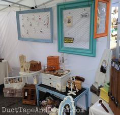 Frames - Side wall of my booth at Treasure Island Flea with the huge frames I painted with CeCe Caldwell's paints and added chicken wire to display earrings   DuctTapeAndDenim.com