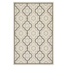 Anchor your patio seating group or define space in the den with this Turkish-made indoor/outdoor rug, showcasing a quatrefoil ogee motif for eye-catching app...