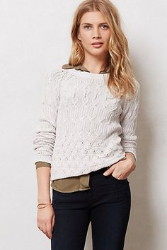 cute Anthropologie sweater with buttons half down the back. it looks pretty cute in the other colors as well: green, mustard, coral