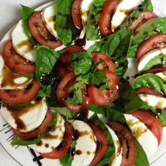 Caprese Salad drizzled with Dove Chocolate Discoveries Raspberry Balsamic Glaze.