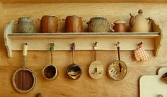 fairy sized kitchen collection made from acorns, nuts & twigs.