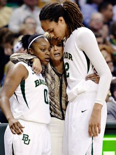 Brittney Griner and Odyssey Sims with coach Kim Mulkey.
