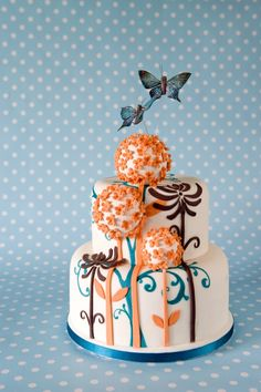 "I love the 3D look.  The painted flowers, the fondant flowers, and the actual ""3d"" ones."