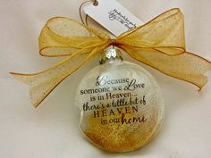 Heaven in our Home memorial Christmas ornament by StickyChicBoutique. So pretty...the phrase floats in the center with a single white feather and a splash of loose glitter. Now available only at https://docs.google.com/forms/d/1hqgeV_haOUkZFqTobfay6Utk2U4kubnpibreuoMh4nQ/viewform?c=0&w=1