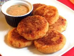 Potato pancakes Ecuadorean-style–llapingachos–are seasoned with Spanish spices, stuffed with cheese, and served with a simple, delicious peanut sauce. Comida Latina, Equador, Potato Pancakes, Peanut Sauce, Latin Food, Mexican Food Recipes, Spanish Recipes, Dinner Recipes, Side Recipes