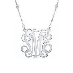 This sterling silver monogram is created with a fancy script font! The made to order monogrammed charm is attached to a CZ studded chain.