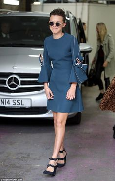 Glamorous: She wore a pair of glittering heels, which matched her frock, and shielded her ...