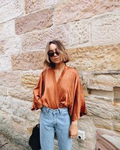 summer looks with this copper satin oversized blouse and basic denim jean.