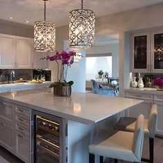 If you have to have a white kitchen and are really into the flow of a single color scheme, colorful flowers and decor are perfect for pops of color to bring life into the space to make it more welcoming