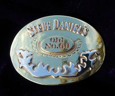 Custom Made Buckle in silver and Brass for Steve Daniels 60th Birthday. Hand crafted by Karen Ryder.