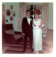 Happy 1960s couple with wrist corsage